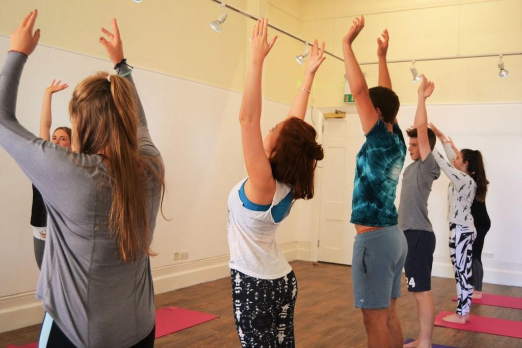 Robin teaches teen yoga class sunsalutations