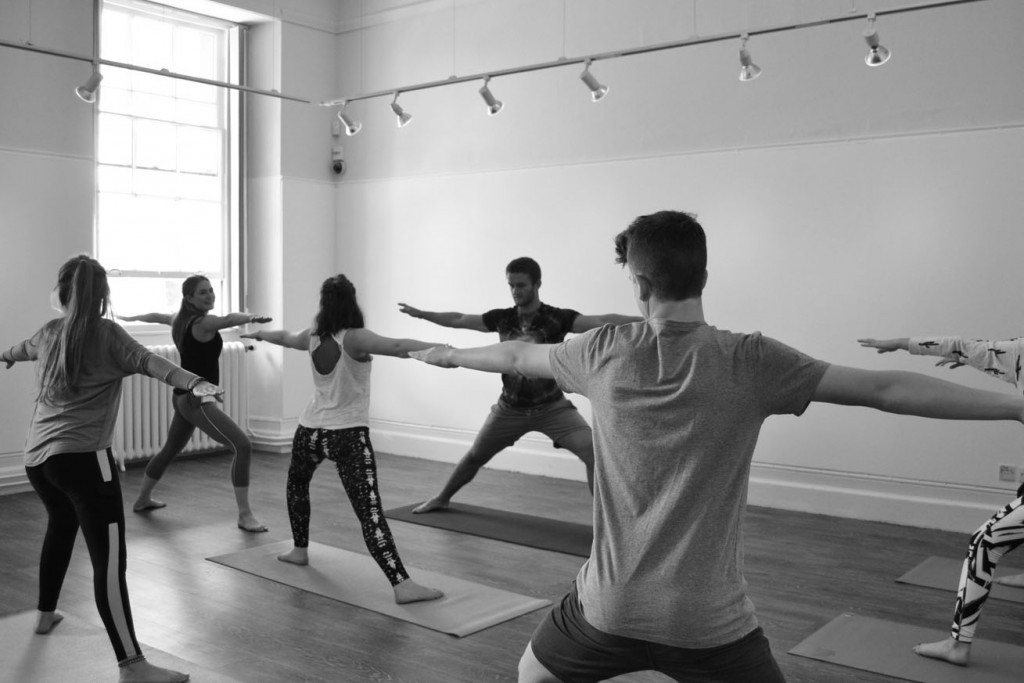 youth yoga class practicing warrior