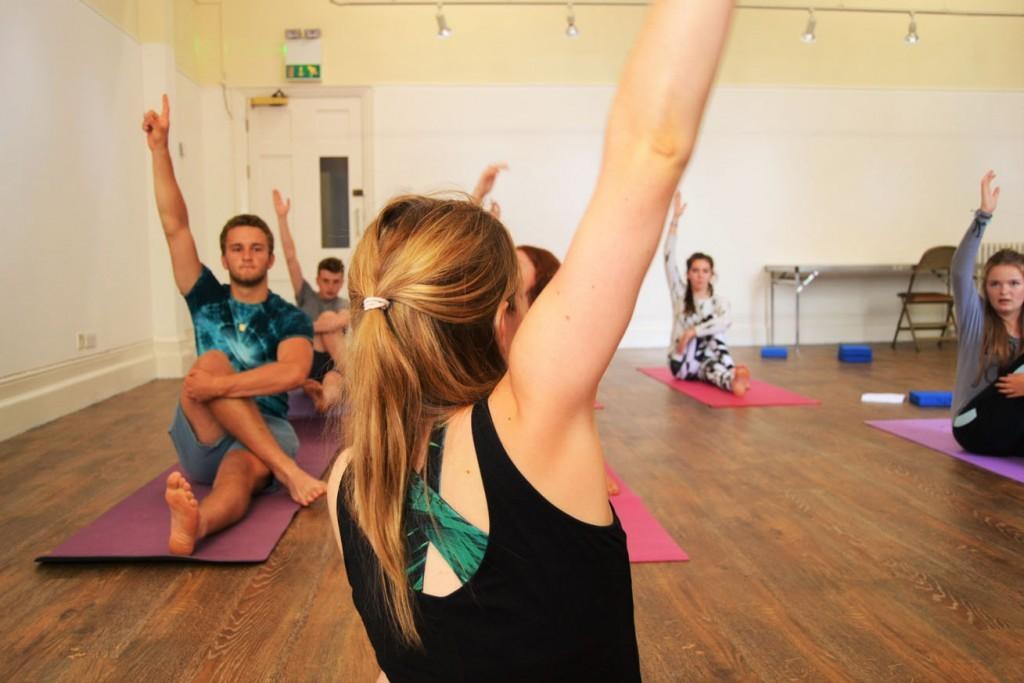 Robin teaches a twist in Teen yoga classes