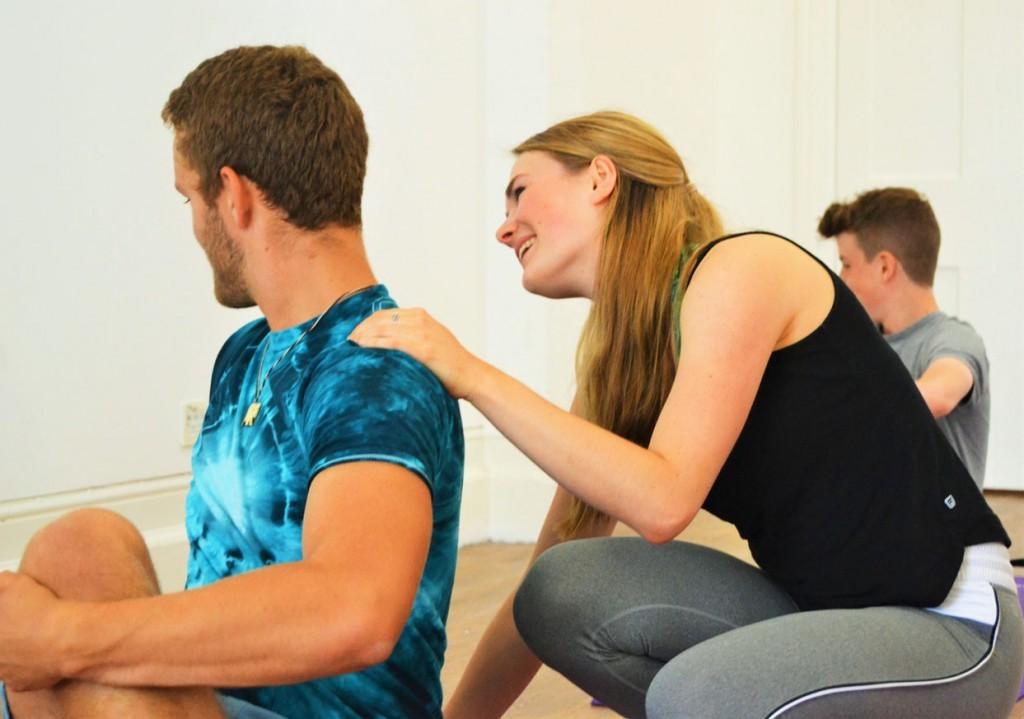 student and teacher in a teen yoga class